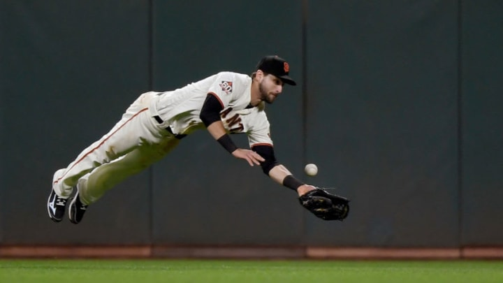 SAN FRANCISCO, CA - JULY 26: Steven Duggar #6 of the San Francisco Giants dives for the ball that goes for a triple off the bat of Brad Miller #10 of the Milwaukee Brewers in the top of the six inning at AT&T Park on July 26, 2018 in San Francisco, California. (Photo by Thearon W. Henderson/Getty Images)