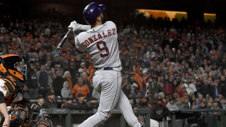 SAN FRANCISCO, CA - AUGUST 06: Marwin Gonzalez #9 of the Houston Astros swings and watches the flight of his ball as he hits a three-run home run against the San Francisco Giants in the top of the ninth inning at AT&T Park on August 6, 2018 in San Francisco, California. The Astros won the game 3-1. (Photo by Thearon W. Henderson/Getty Images)