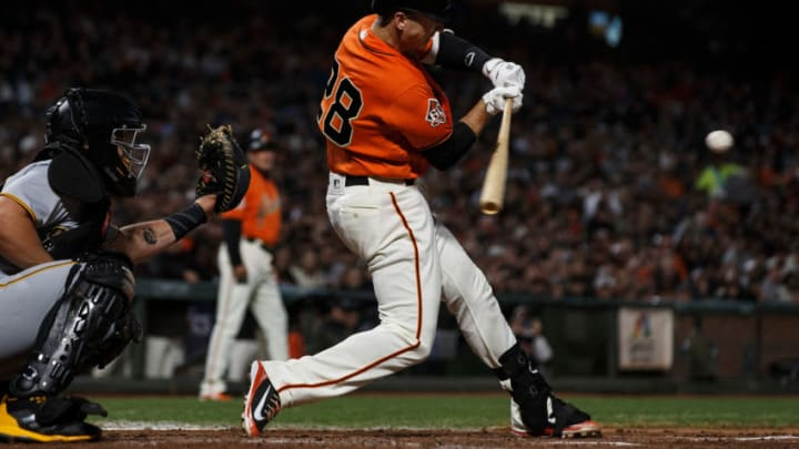 SAN FRANCISCO, CA - AUGUST 10: Buster Posey #28 of the San Francisco Giants hits a two run single against the Pittsburgh Pirates during the third inning at AT&T Park on August 10, 2018 in San Francisco, California. The San Francisco Giants defeated the Pittsburgh Pirates 13-10. (Photo by Jason O. Watson/Getty Images)