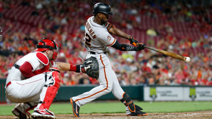 CINCINNATI, OH - AUGUST 17: Andrew McCutchen #22 of the San Francisco Giants hits a single during the eighth inning of the game against the Cincinnati Reds at Great American Ball Park on August 17, 2018 in Cincinnati, Ohio. Cincinnati defeated San Francisco 2-1 in 11 innings. (Photo by Kirk Irwin/Getty Images)