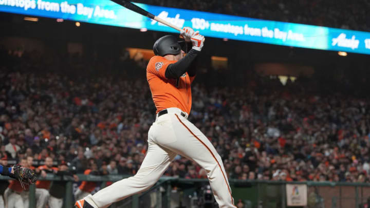 SAN FRANCISCO, CA - AUGUST 31: Chris Shaw #26 of the San Francisco Giants in his major league debut hits a sacrifice fly scoring Brandon Belt #9 in the bottom of the seventh inning at AT&T Park on August 31, 2018 in San Francisco, California. (Photo by Thearon W. Henderson/Getty Images)