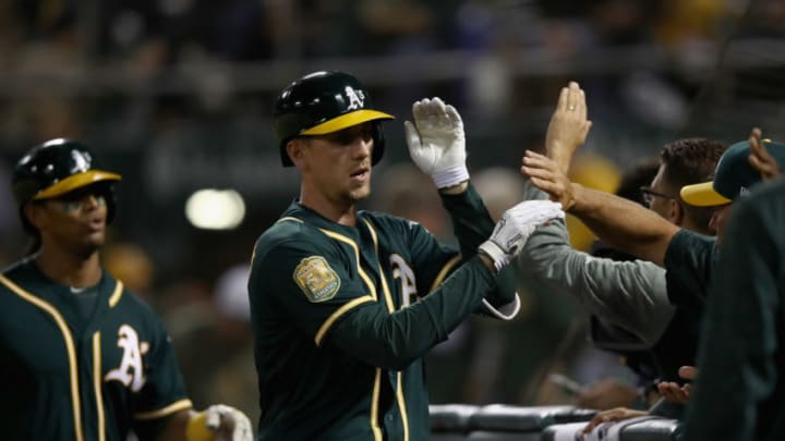 OAKLAND, CA - SEPTEMBER 19: Stephen Piscotty #25 of the Oakland Athletics is congratulated by teammates after hitting a three-run home run in the fifth inning against the Los Angeles Angels at Oakland Alameda Coliseum on September 19, 2018 in Oakland, California. (Photo by Ezra Shaw/Getty Images)