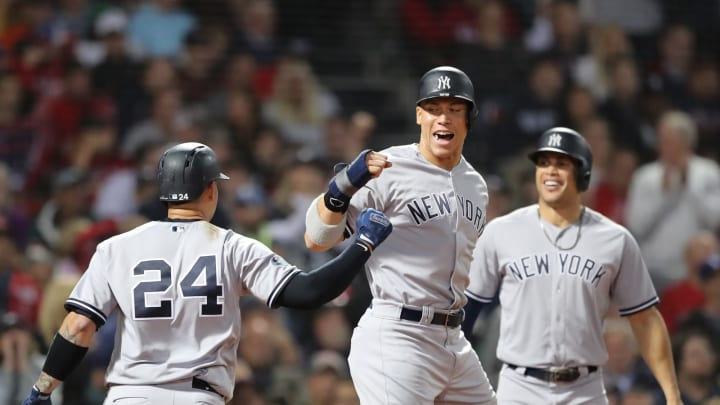 BOSTON, MA – OCTOBER 06: Gary Sanchez #24 and Aaron Judge #99 of the New York Yankees celebrate after Sanchez hit a three-run home run as teammate Giancarlo Stanton #27 watches during the seventh inning of Game Two of the American League Division Series against the Boston Red Sox at Fenway Park on October 6, 2018 in Boston, Massachusetts. (Photo by Elsa/Getty Images)