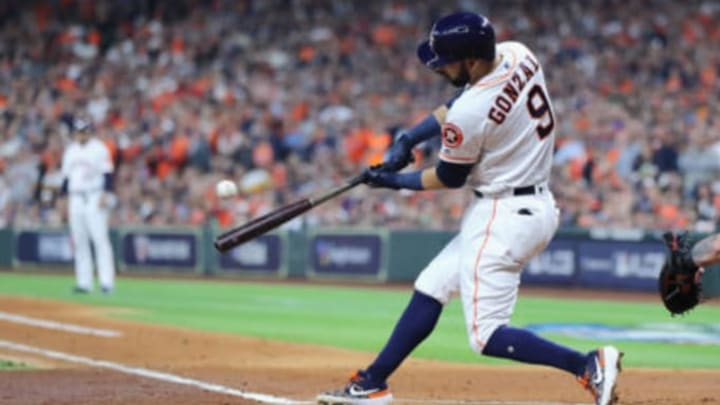 HOUSTON, TX – OCTOBER 16: Marwin Gonzalez #9 of the Houston Astros hits a RBI single in the first inning against the Boston Red Sox during Game Three of the American League Championship Series at Minute Maid Park on October 16, 2018 in Houston, Texas. (Photo by Elsa/Getty Images)