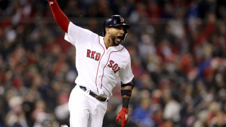 BOSTON, MA - OCTOBER 23: Eduardo Nunez #36 of the Boston Red Sox celebrates his three-run home run during the seventh inning against the Los Angeles Dodgers in Game One of the 2018 World Series at Fenway Park on October 23, 2018 in Boston, Massachusetts. (Photo by Maddie Meyer/Getty Images)