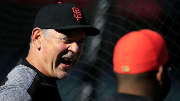 SAN FRANCISCO, CALIFORNIA - APRIL 09: Bruce Bochy #15 of the San Francisco Giants speaks to players during batting practice prior to the first inning against the San Diego Padres at Oracle Park on April 09, 2019 in San Francisco, California. (Photo by Daniel Shirey/Getty Images)