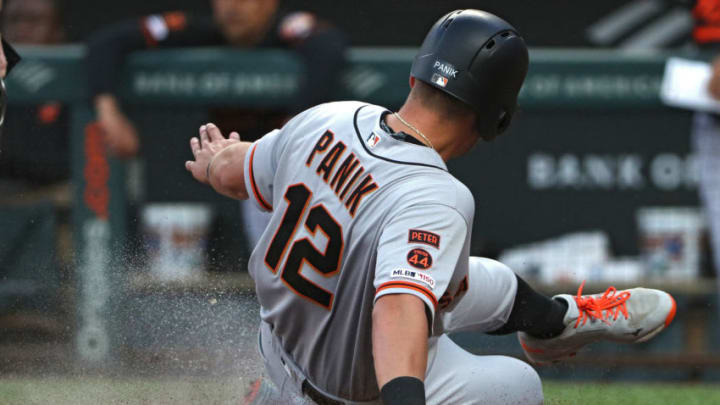 BALTIMORE, MARYLAND - MAY 31: Joe Panik #12 of the San Francisco Giants scores against the Baltimore Orioles during the first inning at Oriole Park at Camden Yards on May 31, 2019 in Baltimore, Maryland. (Photo by Patrick Smith/Getty Images)