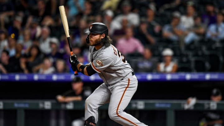 DENVER, CO - JULY 16: Brandon Crawford #35 of the San Francisco Giants hits an RBI single in the 10th inning against the Colorado Rockies at Coors Field on July 16, 2019 in Denver, Colorado. (Photo by Dustin Bradford/Getty Images)