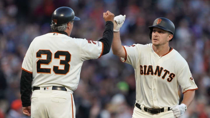SAN FRANCISCO, CA - JULY 23: Alex Dickerson #8 of the San Francisco Giants is congratulated by third base coach Ron Wotus #23 after Dickerson hit a solo home run against the Chicago Cubs in the bottom of the fourth inning at Oracle Park on July 23, 2019 in San Francisco, California. (Photo by Thearon W. Henderson/Getty Images)