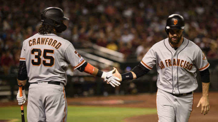 San Francisco Giants Brandon Crawford and Brandon Belt slap hands. (Photo by Jennifer Stewart/Getty Images)