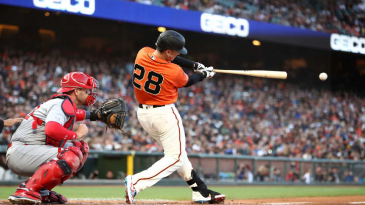 SAN FRANCISCO, CALIFORNIA - JULY 05: Buster Posey #28 of the San Francisco Giants hits a single in the first inning at Oracle Park on July 05, 2019 in San Francisco, California. (Photo by Ezra Shaw/Getty Images)