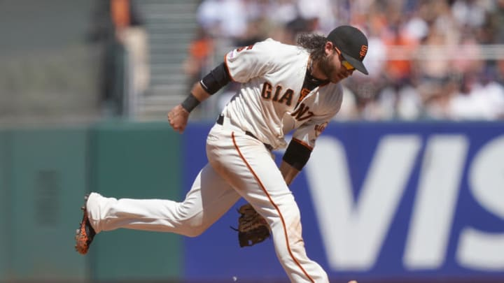 Brandon Crawford #35 of the San Francisco Giants bobbles a ball in 2019. (Photo by Thearon W. Henderson/Getty Images)