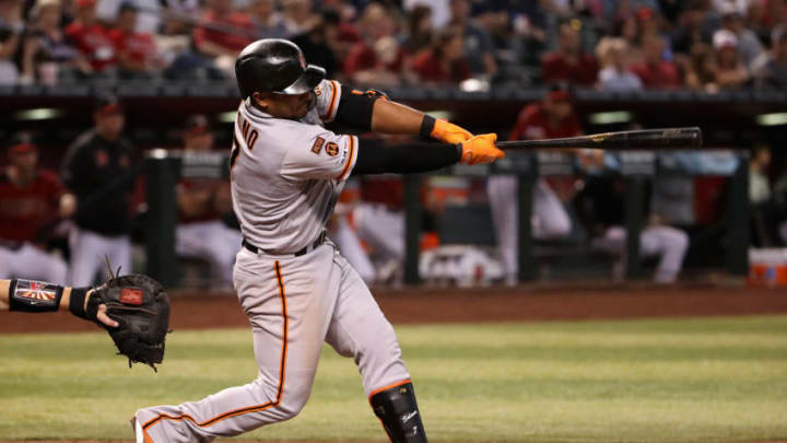 PHOENIX, ARIZONA - AUGUST 18: Donovan Solano #7 of the San Francisco Giants hits a single against the Arizona Diamondbacks during the fifth inning of the MLB game at Chase Field on August 18, 2019 in Phoenix, Arizona. (Photo by Christian Petersen/Getty Images)