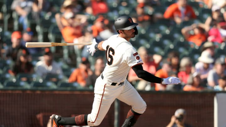 SAN FRANCISCO, CALIFORNIA - SEPTEMBER 26: Aramis Garcia #16 of the San Francisco Giants hits a single that scored two runs in the eight eighth inning against the Colorado Rockies at Oracle Park on September 26, 2019 in San Francisco, California. (Photo by Ezra Shaw/Getty Images)