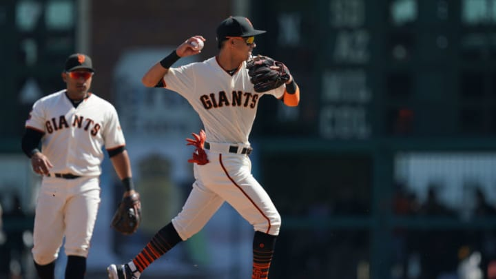 SAN FRANCISCO, CALIFORNIA - SEPTEMBER 28: Mauricio Dubon #19 of the San Francisco Giants looks to throw to first base to complete the double play against the Los Angeles Dodgers in the top of the fourth inning at Oracle Park on September 28, 2019 in San Francisco, California. (Photo by Thearon W. Henderson/Getty Images)