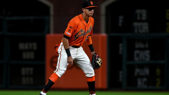 SAN FRANCISCO, CALIFORNIA - SEPTEMBER 27: Mauricio Dubon #19 of the San Francisco Giants defends against the Los Angeles Dodgers during their MLB game at Oracle Park on September 27, 2019 in San Francisco, California. (Photo by Robert Reiners/Getty Images)