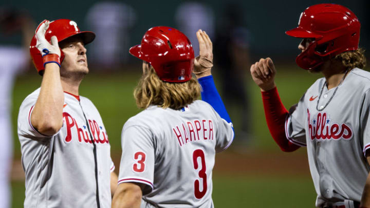BOSTON, MA - AUGUST 18: Jay Bruce #9 of the Philadelphia Phillies high fives Bryce Harper after hitting a three run home run during the seventh inning of a game against the Boston Red Sox on August 18, 2020 at Fenway Park in Boston, Massachusetts. (Photo by Billie Weiss/Boston Red Sox/Getty Images)