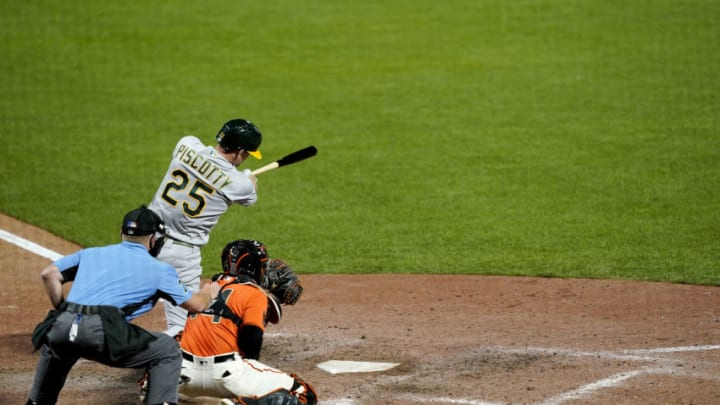 SAN FRANCISCO, CALIFORNIA - AUGUST 14: Stephen Piscotty #25 of the Oakland Athletics hits a grand slam home run against the San Francisco Giants in the top of the ninth inning at Oracle Park on August 14, 2020 in San Francisco, California. Piscotty's home run tied the game at 7-7. (Photo by Thearon W. Henderson/Getty Images)