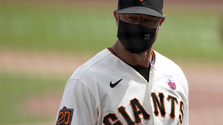 SAN FRANCISCO, CALIFORNIA - AUGUST 16: Manager Gabe Kapler #19 looks on as he walks back to the dugout after making a pitching change against the Oakland Athletics in the top of the fifth inning at Oracle Park on August 16, 2020 in San Francisco, California. (Photo by Thearon W. Henderson/Getty Images)