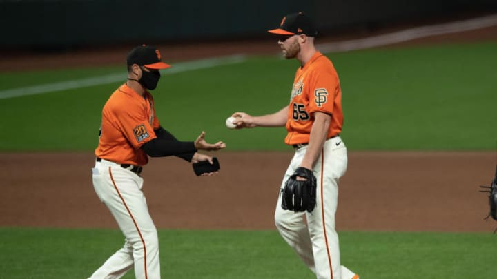 Sam Coonrod #65 of the SF Giants is relieved by manager Gabe Kapler. (Photo by Jason O. Watson/Getty Images)