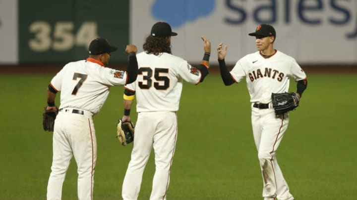 Donovan Solano #7, Brandon Crawford #35 and Mauricio Dubòn #1 of the SF Giants celebrate after a win against the Seattle Mariners at Oracle Park. (Photo by Lachlan Cunningham/Getty Images)