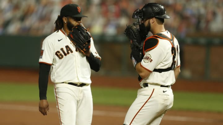 SAN FRANCISCO, CALIFORNIA - SEPTEMBER 21: Starting pitcher Johnny Cueto #47 of the SF Giants talks to catcher Joey Bart during the game against the Colorado Rockies at Oracle Park on September 21, 2020 in San Francisco, California. (Photo by Lachlan Cunningham/Getty Images)