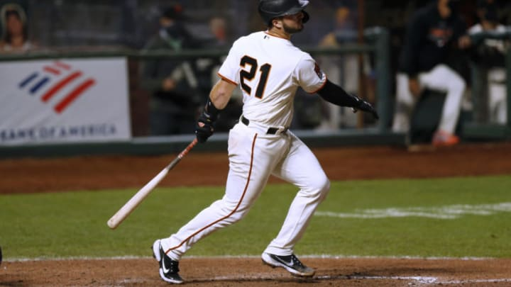 SAN FRANCISCO, CALIFORNIA - SEPTEMBER 23: Joey Bart #21 of the SF Giants hits a triple in the bottom of the eighth inning against the Colorado Rockies at Oracle Park on September 23, 2020 in San Francisco, California. (Photo by Lachlan Cunningham/Getty Images)