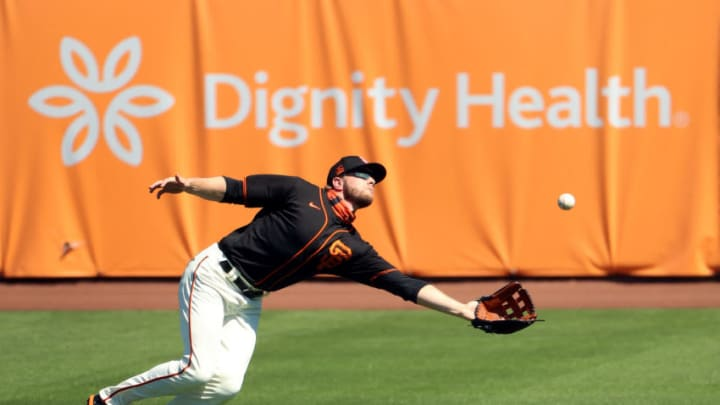 SCOTTSDALE, ARIZONA - MARCH 28: Austin Slater #13 of the SF Giants catches a fly out in the third inning against the Oakland Athletics during the MLB spring training game at Scottsdale Stadium on March 28, 2021 in Scottsdale, Arizona. (Photo by Abbie Parr/Getty Images)