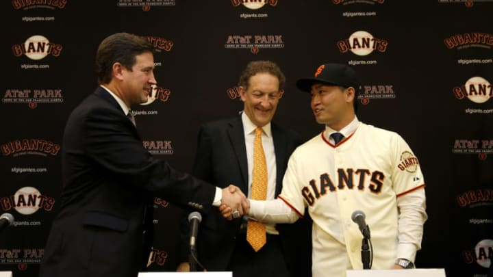 SAN FRANCISCO, CA - JANUARY 20: Norichika Aoki poses for a picture with Larry Baer, President and CEO of the San Francisco Giants and Bobby Evans (left), Vice President and Assistant General Manager of the San Francisco Giants during a press conference where he was introduced as the newest Giant at AT&T Park on January 20, 2015 in San Francisco, California. (Photo by Ezra Shaw/Getty Images)