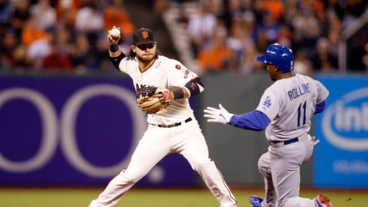 SAN FRANCISCO, CA - SEPTEMBER 30: Brandon Crawford #35 of the San Francisco Giants turns a double play as Jimmy Rollins #11 of the Los Angeles Dodgers slides into second base on a ball hit by Corey Seager #5 in the first inning at AT&T Park on September 30, 2015 in San Francisco, California. (Photo by Ezra Shaw/Getty Images)
