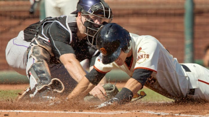 SAN FRANCISCO, CA - OCTOBER 3: Second baseman Kelby Tomlinson #37 of the San Francisco Giants dives across home plate against catcher Tom Murphy #30 of the Colorado Rockies for an in-the-park home run in the first inning at AT&T Park on October 3, 2015 in San Francisco, California. The Giants won 3-2. (Photo by Brian Bahr/Getty Images)