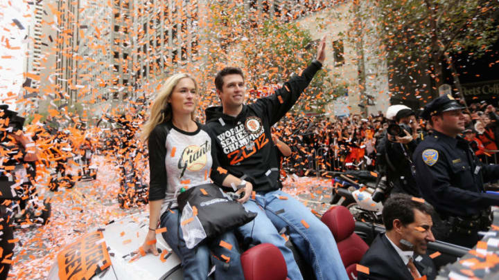 SAN FRANCISCO, CA - OCTOBER 31: Buster Posey #28 of the San Francisco Giants rides along the parade route during the San Francisco Giants World Series victory parade on October 31, 2012 in San Francisco, California. The San Francisco Giants beat the Detroit Tigers to win the 2012 World Series. (Photo by Ezra Shaw/Getty Images)