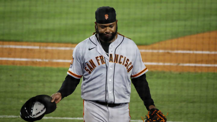 SF Giants starter Johnny Cueto walks off the field after giving up a three-run home run.