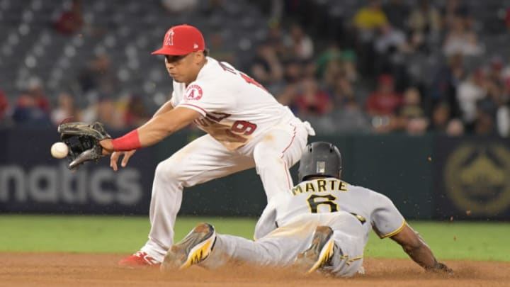 Los Angeles Angels shortstop Wilfredo Tovar (19) attempts to tag out Pittsburgh Pirates center fielder Starling Marte (6) at second base at Angel Stadium of Anaheim. The Pirates defeated the Angels 10-2. (Kirby Lee-USA TODAY Sports)
