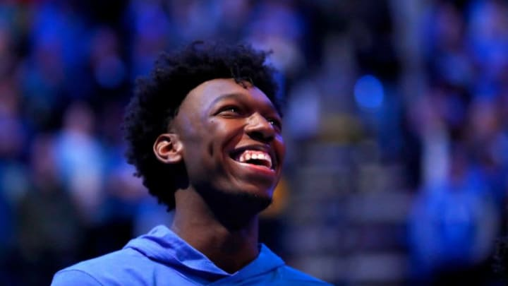 Memphis Tigers center James Wiseman, who is serving an NCAA suspension, smiles as his teammates are introduced before their game against Ole Miss at the FedExForum on Saturday, Nov. 23, 2019. W 21828