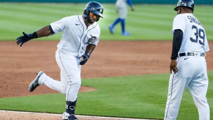 Tigers left fielder Christin Stewart high-fives third base coach Ramon Santiago after scoring a two-run home run against the Royals during the third inning at Comerica Park on Tuesday, July 28, 2020.