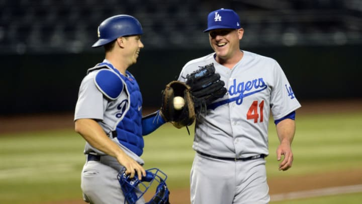 Aug 1, 2020; Phoenix, Arizona, USA; Los Angeles Dodgers catcher Will Smith (16) and relief pitcher Jake McGee (41) celebrate after the ninth inning against the Arizona Diamondbacks at Chase Field. Mandatory Credit: Joe Camporeale-USA TODAY Sports