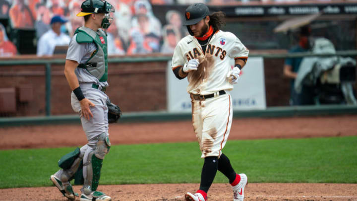 SF Giants shortstop Brandon Crawford (35) scores on a RBI single from right fielder Mike Yastrzemski (not pictured) during the third inning against the Oakland Athletics at Oracle Park. (Neville E. Guard-USA TODAY Sports)