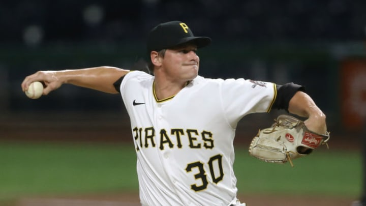 Jul 27, 2020; Pittsburgh, Pennsylvania, USA; Pittsburgh Pirates relief pitcher Kyle Crick (30) pitches against the Milwaukee Brewers during the ninth inning at PNC Park. Milwaukee won 6-5 in eleven innings. (Charles LeClaire-USA TODAY Sports)