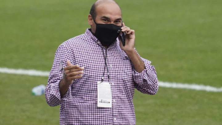 Aug 26, 2020; San Francisco, California, USA; San Francisco Giants president of baseball operations Farhan Zaidi talks on the cell phone before the game against the Los Angeles Dodgers at Oracle Park. Mandatory Credit: Kyle Terada-USA TODAY Sports