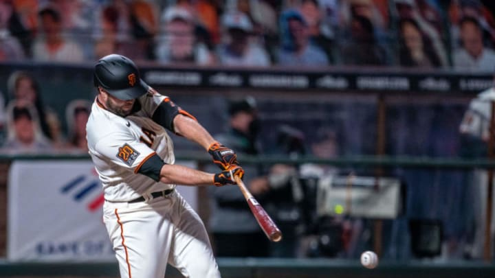 Sep 22, 2020; San Francisco, California, USA; San Francisco Giants left fielder Darin Ruf (33) hits a single during the sixth inning against the Colorado Rockies at Oracle Park. Mandatory Credit: Neville E. Guard-USA TODAY Sports