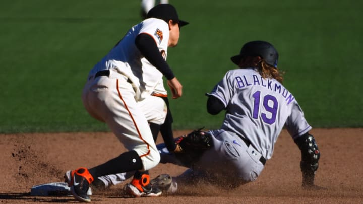 Sep 24, 2020; San Francisco, California, USA; Colorado Rockies right fielder Charlie Blackmon (19) is tagged out by San Francisco Giants second baseman Wilmer Flores (41) while trying to steal second base during the ninth inning at Oracle Park. Mandatory Credit: Kelley L Cox-USA TODAY Sports