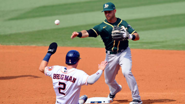 Oct 8, 2020; Los Angeles, California, USA; Oakland Athletics second baseman Tommy La Stella (3) forces out Houston Astros third baseman Alex Bregman (2) at second base during the third inning during game four of the 2020 ALDS at Dodger Stadium. Mandatory Credit: Jayne Kamin-Oncea-USA TODAY Sports