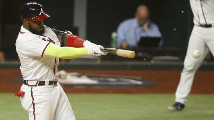 Atlanta designated hitter Marcell Ozuna (20) drives in a run with a single against the Los Angeles Dodgers during the eighth inning of game four of the 2020 NLCS at Globe Life Field. (Tim Heitman-USA TODAY Sports)