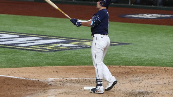 Oct 24, 2020; Arlington, Texas, USA; Tampa Bay Rays right fielder Hunter Renfroe (11) hits a home run against the Los Angeles Dodgers during the fifth inning of game four of the 2020 World Series at Globe Life Field. Mandatory Credit: Kevin Jairaj-USA TODAY Sports