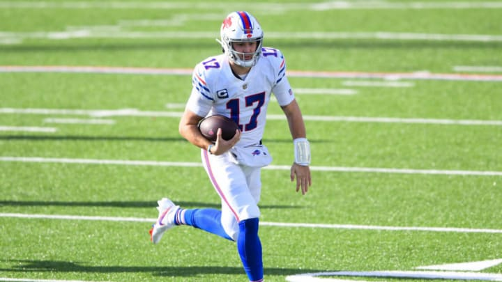 Nov 29, 2020; Orchard Park, New York, USA; Buffalo Bills quarterback Josh Allen (17) runs with the ball against the Los Angeles Chargers during the first quarter at Bills Stadium. Mandatory Credit: Rich Barnes-USA TODAY Sports
