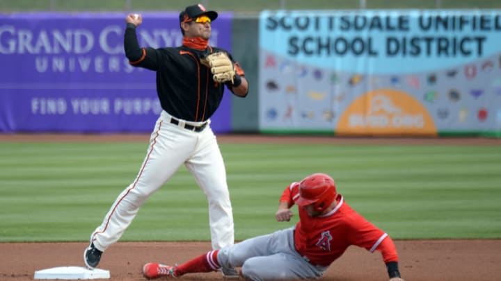 SF Giants infielder Donovan Solano (7) throws to first against the Los Angeles Angels during the first inning at Scottsdale Stadium. (Joe Camporeale-USA TODAY Sports)