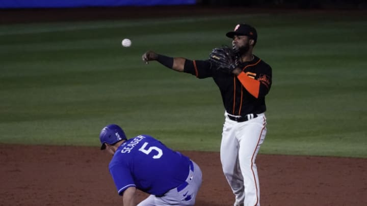 SF Giants second baseman Arismendy Alc‡ntara turns the double play while avoiding Los Angeles Dodgers shortstop Corey Seager (5) in the third inning during a spring training game at Scottsdale Stadium. Mandatory Credit: Rick Scuteri-USA TODAY Sports
