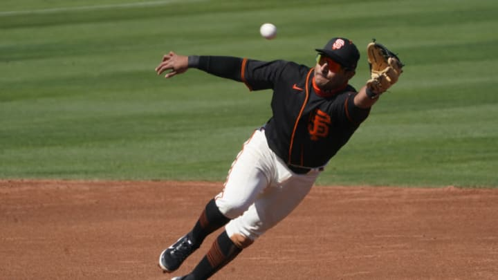 SF Giants shortstop Donovan Solano (7) dives for the ball against the Chicago Cubs during a spring training game at Scottsdale Stadium. (Rick Scuteri-USA TODAY Sports)