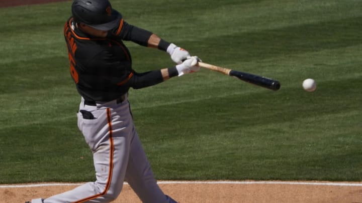 SF Giants infielder Will Wilson (85) hits a three run double against the Los Angeles Angels during a spring training game at Tempe Diablo Stadium. (Rick Scuteri-USA TODAY Sports)